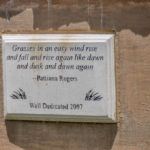 Plaque: Grasses in an easy wind rise and fall and rise again like dawn and dusk and dawn again - Pattiann Rogers Wall dedicated 2007
